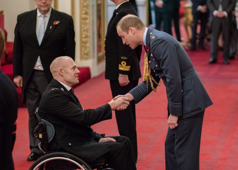 Prince William presenting PC Prdley with his MBE. s